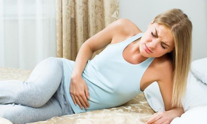 К побочным эффектам относят спазмы в животе